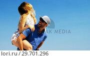 Купить «Couple enjoying together at beach», видеоролик № 29701296, снято 17 января 2017 г. (c) Wavebreak Media / Фотобанк Лори