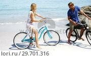 Купить «Couple riding bicycle at beach», видеоролик № 29701316, снято 17 января 2017 г. (c) Wavebreak Media / Фотобанк Лори