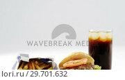 Купить «Snacks and cold drink against white background», видеоролик № 29701632, снято 13 января 2017 г. (c) Wavebreak Media / Фотобанк Лори