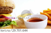 Купить «Snacks with ketchup on wooden board», видеоролик № 29701644, снято 13 января 2017 г. (c) Wavebreak Media / Фотобанк Лори