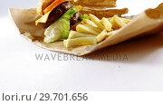 Купить «Hamburger and french fries on table», видеоролик № 29701656, снято 13 января 2017 г. (c) Wavebreak Media / Фотобанк Лори