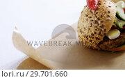 Купить «Hamburger and french fries on table», видеоролик № 29701660, снято 13 января 2017 г. (c) Wavebreak Media / Фотобанк Лори