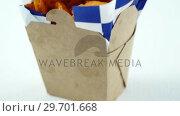 Купить «French fried chips in a take away container», видеоролик № 29701668, снято 13 января 2017 г. (c) Wavebreak Media / Фотобанк Лори