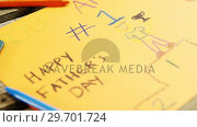 Купить «Paintings and happy fathers day message on paper», видеоролик № 29701724, снято 13 января 2017 г. (c) Wavebreak Media / Фотобанк Лори