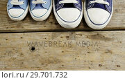 Купить «Pairs of new shoes on wooden plank», видеоролик № 29701732, снято 13 января 2017 г. (c) Wavebreak Media / Фотобанк Лори