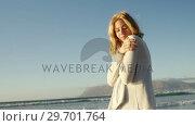 Купить «Young woman walking on shore at beach», видеоролик № 29701764, снято 1 марта 2017 г. (c) Wavebreak Media / Фотобанк Лори
