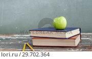 Купить «Green apple on book stack», видеоролик № 29702364, снято 5 апреля 2017 г. (c) Wavebreak Media / Фотобанк Лори