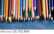 Купить «Various color pencils arranged on wooden table», видеоролик № 29702404, снято 5 апреля 2017 г. (c) Wavebreak Media / Фотобанк Лори