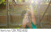 Купить «Fit woman climbing the rope during obstacle course», видеоролик № 29702632, снято 16 марта 2017 г. (c) Wavebreak Media / Фотобанк Лори