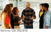 Купить «Team of executives interacting with each other while working in the office», видеоролик № 29702816, снято 26 марта 2017 г. (c) Wavebreak Media / Фотобанк Лори