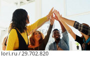 Купить «Group of happy executives giving high five to each other», видеоролик № 29702820, снято 26 марта 2017 г. (c) Wavebreak Media / Фотобанк Лори