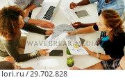 Купить «Team of executives interacting with each other while working in the office», видеоролик № 29702828, снято 26 марта 2017 г. (c) Wavebreak Media / Фотобанк Лори