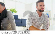 Купить «Business colleagues discussing over documents», видеоролик № 29702832, снято 26 марта 2017 г. (c) Wavebreak Media / Фотобанк Лори