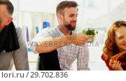 Купить «Group of happy executives having pizza», видеоролик № 29702836, снято 26 марта 2017 г. (c) Wavebreak Media / Фотобанк Лори