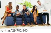 Купить «Business colleagues sitting together on a couch», видеоролик № 29702840, снято 26 марта 2017 г. (c) Wavebreak Media / Фотобанк Лори