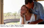 Купить «Man covering woman eyes while giving surprise in restaurant 4k», видеоролик № 29703528, снято 28 марта 2017 г. (c) Wavebreak Media / Фотобанк Лори