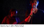 Купить «Male singer singing into a microphone 4k», видеоролик № 29703532, снято 7 марта 2017 г. (c) Wavebreak Media / Фотобанк Лори