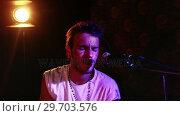 Купить «Male singer singing into a microphone 4k», видеоролик № 29703576, снято 7 марта 2017 г. (c) Wavebreak Media / Фотобанк Лори