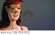 Купить «Portrait of beautiful woman wearing masquerade mask 4k», видеоролик № 29703912, снято 22 мая 2017 г. (c) Wavebreak Media / Фотобанк Лори