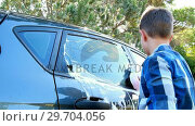 Купить «Boy washing a car 4k», видеоролик № 29704056, снято 3 февраля 2017 г. (c) Wavebreak Media / Фотобанк Лори