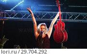 Купить «Singer performing on stage», видеоролик № 29704292, снято 7 марта 2017 г. (c) Wavebreak Media / Фотобанк Лори