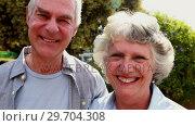 Купить «Senior couple standing in garden 4k», видеоролик № 29704308, снято 20 марта 2017 г. (c) Wavebreak Media / Фотобанк Лори