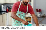 Купить «Man ironing clothes in kitchen 4k», видеоролик № 29704388, снято 20 марта 2017 г. (c) Wavebreak Media / Фотобанк Лори