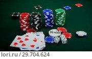 Купить «Playing card, dices and casino chips on poker table 4k», видеоролик № 29704624, снято 6 апреля 2017 г. (c) Wavebreak Media / Фотобанк Лори