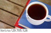 Купить «Black coffee on book stack 4k», видеоролик № 29705128, снято 26 мая 2017 г. (c) Wavebreak Media / Фотобанк Лори