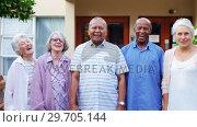 Купить «Happy senior friends standing together in lawn 4k», видеоролик № 29705144, снято 28 апреля 2017 г. (c) Wavebreak Media / Фотобанк Лори