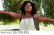 Купить «Woman with her arms wide open 4k», видеоролик № 29705852, снято 9 марта 2017 г. (c) Wavebreak Media / Фотобанк Лори