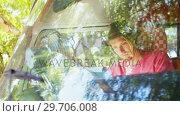 Купить «Man reading map in camper van 4k», видеоролик № 29706008, снято 9 марта 2017 г. (c) Wavebreak Media / Фотобанк Лори