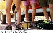 Купить «Friends standing near camper van 4k», видеоролик № 29706024, снято 9 марта 2017 г. (c) Wavebreak Media / Фотобанк Лори