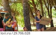 Купить «Group of friends asking for lift on road 4k», видеоролик № 29706028, снято 9 марта 2017 г. (c) Wavebreak Media / Фотобанк Лори