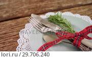 Купить «Various cutlery on wooden table 4k», видеоролик № 29706240, снято 14 июня 2017 г. (c) Wavebreak Media / Фотобанк Лори