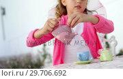 Купить «Girl in fairy costume pouring tea into cup 4k», видеоролик № 29706692, снято 24 марта 2017 г. (c) Wavebreak Media / Фотобанк Лори