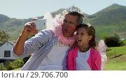 Купить «Smiling father and daughter in fairy costume taking selfie with mobile phone 4k», видеоролик № 29706700, снято 24 марта 2017 г. (c) Wavebreak Media / Фотобанк Лори