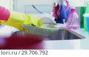 Купить «Woman washing utensil in kitchen sink 4k», видеоролик № 29706792, снято 24 марта 2017 г. (c) Wavebreak Media / Фотобанк Лори
