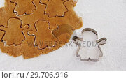 Купить «Flattened dough cut with a cookie cutter 4k», видеоролик № 29706916, снято 5 мая 2017 г. (c) Wavebreak Media / Фотобанк Лори