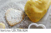 Купить «Raw heart shape cookies with sugar icing on wax paper 4k», видеоролик № 29706924, снято 5 мая 2017 г. (c) Wavebreak Media / Фотобанк Лори