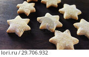Купить «Gingerbread cookies with powdered sugar sprinkled on top 4k», видеоролик № 29706932, снято 5 мая 2017 г. (c) Wavebreak Media / Фотобанк Лори