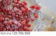 Купить «Red berries on tart with whisker and rolling pin 4k», видеоролик № 29706968, снято 5 мая 2017 г. (c) Wavebreak Media / Фотобанк Лори