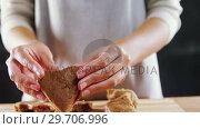 Купить «Woman molding gingerbread dough on wooden board 4k», видеоролик № 29706996, снято 5 мая 2017 г. (c) Wavebreak Media / Фотобанк Лори