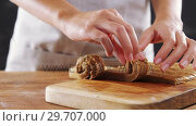 Купить «Woman rolling dough on chopping board 4k», видеоролик № 29707000, снято 5 мая 2017 г. (c) Wavebreak Media / Фотобанк Лори