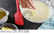 Купить «Woman adding butter cubes to batter in bowl 4k», видеоролик № 29707036, снято 5 мая 2017 г. (c) Wavebreak Media / Фотобанк Лори
