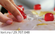 Купить «Woman topping a fresh baked cake with cherry 4k», видеоролик № 29707048, снято 5 мая 2017 г. (c) Wavebreak Media / Фотобанк Лори