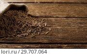 Купить «Cereal bran sticks spilling out of sack 4k», видеоролик № 29707064, снято 13 июня 2017 г. (c) Wavebreak Media / Фотобанк Лори