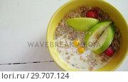 Купить «Bowl of fruit cereal 4k», видеоролик № 29707124, снято 13 июня 2017 г. (c) Wavebreak Media / Фотобанк Лори