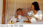 Couple having breakfast in canopy bed 4k. Стоковое видео, агентство Wavebreak Media / Фотобанк Лори