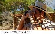 Купить «Man looking through binocular 4k», видеоролик № 29707472, снято 12 мая 2017 г. (c) Wavebreak Media / Фотобанк Лори